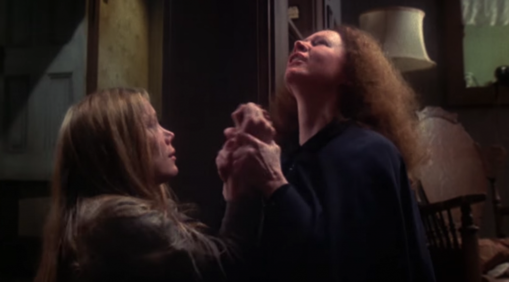 Margaret White forcing Carrie to pray for her sins (Courtesy: Scream Factory)