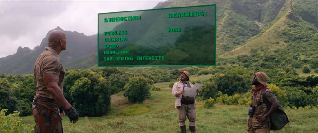 Dr. Smolder Bravestone (Dwayne Johnson), Professor Shelly Oberon (Jack Black) and Mouse Finbar (Kevin Hart) look at Spencer's new stats in 'Jumanji: Welcome to the Jungle' (Courtesy: Sony Pictures)