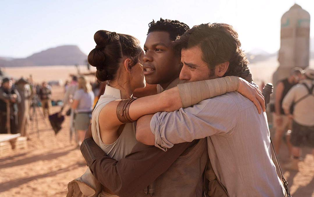 Rey (Daisy Ridley), Finn (John Boyega) and Poe Dameron (Oscar Isaac) all share a hug in 'Star Wars: The Rise of Skywalker' (Courtesy: Lucasfilm)