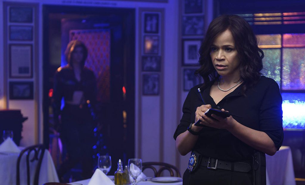 Rosie Perez as Renee Montoya (Courtesy: Warner Bros.)
