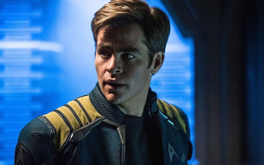 A younger version of Captain James T. Kirk stares into the middle distance