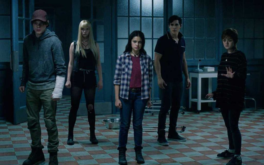 Five teenagers stand in an old-fashioned operating room