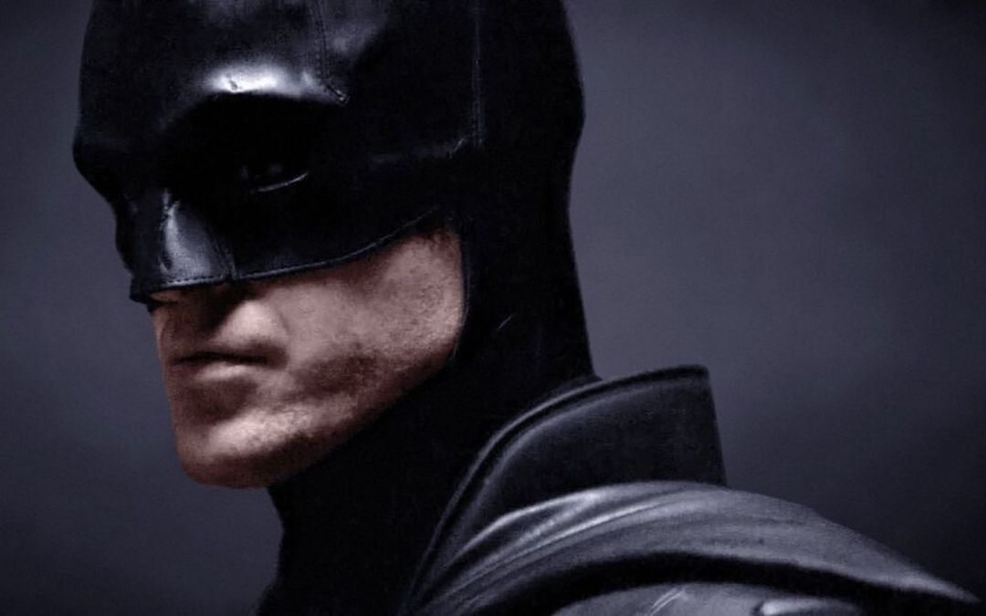 A colorized close-up of Robert Pattinson in the cowl as Batman.