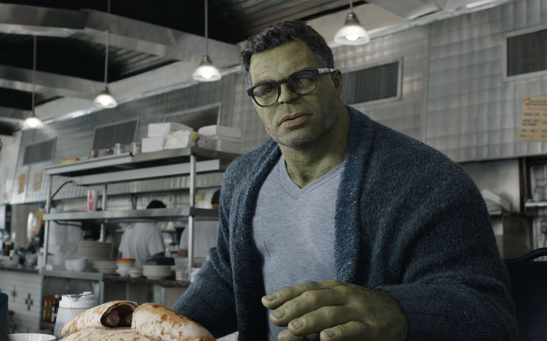 A smarter version of the Hulk wearing a cardigan and glasses talks to Natasha Romanoff