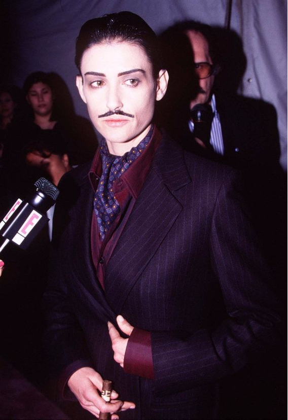 emi Moore showed up dressed like Gomez Addams (?) to a benefit.   Go