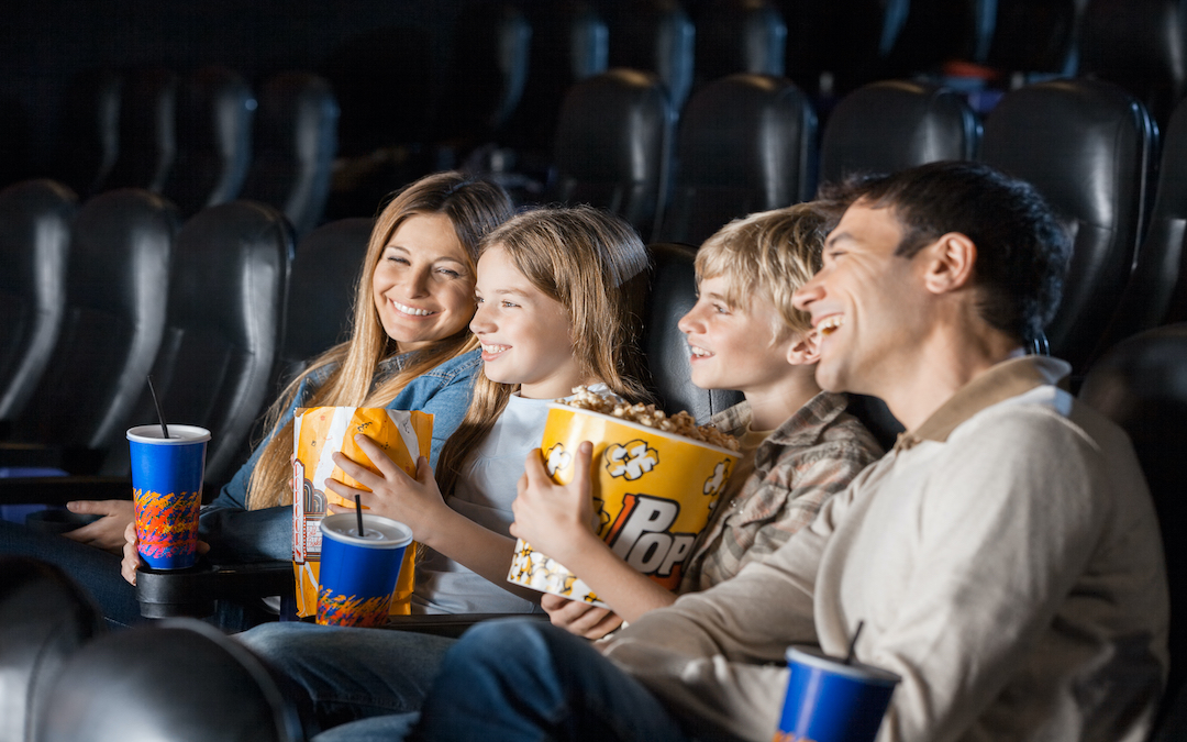 Family enjoys a Private Watch Party in a movie theater